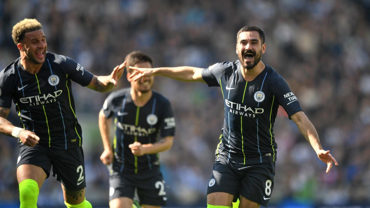 Ilkay Gundogan of Manchester City celebrates after scoring his team's fourth goal during the Premier League match between Brighton & Hove Albion and Manchester City