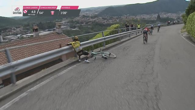 Roglic crashes, almost topples over road barrier