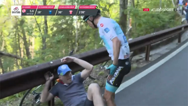 WATCH: Shocking moment rider attacks fan after crashing during Giro