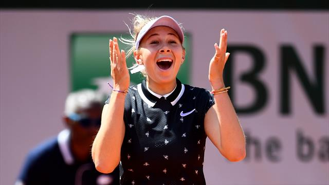Teenager Anisimova stuns defending champ Halep to reach final four