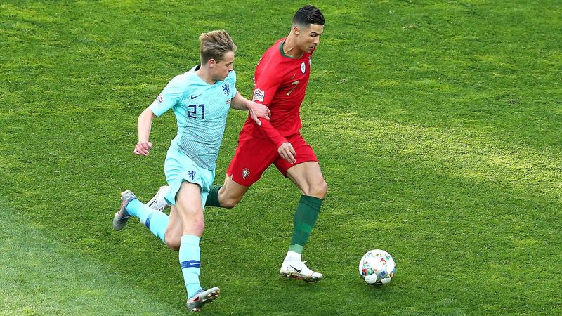 PORTO, PORTUGAL - JUNE 09: Cristiano Ronaldo of Portugal battles for possession with Frenkie de Jong of the Netherlands during the UEFA Nations League Final between Portugal and the Netherlands at Estadio do Dragao on June 09, 2019 in Porto, Portugal. (Ph