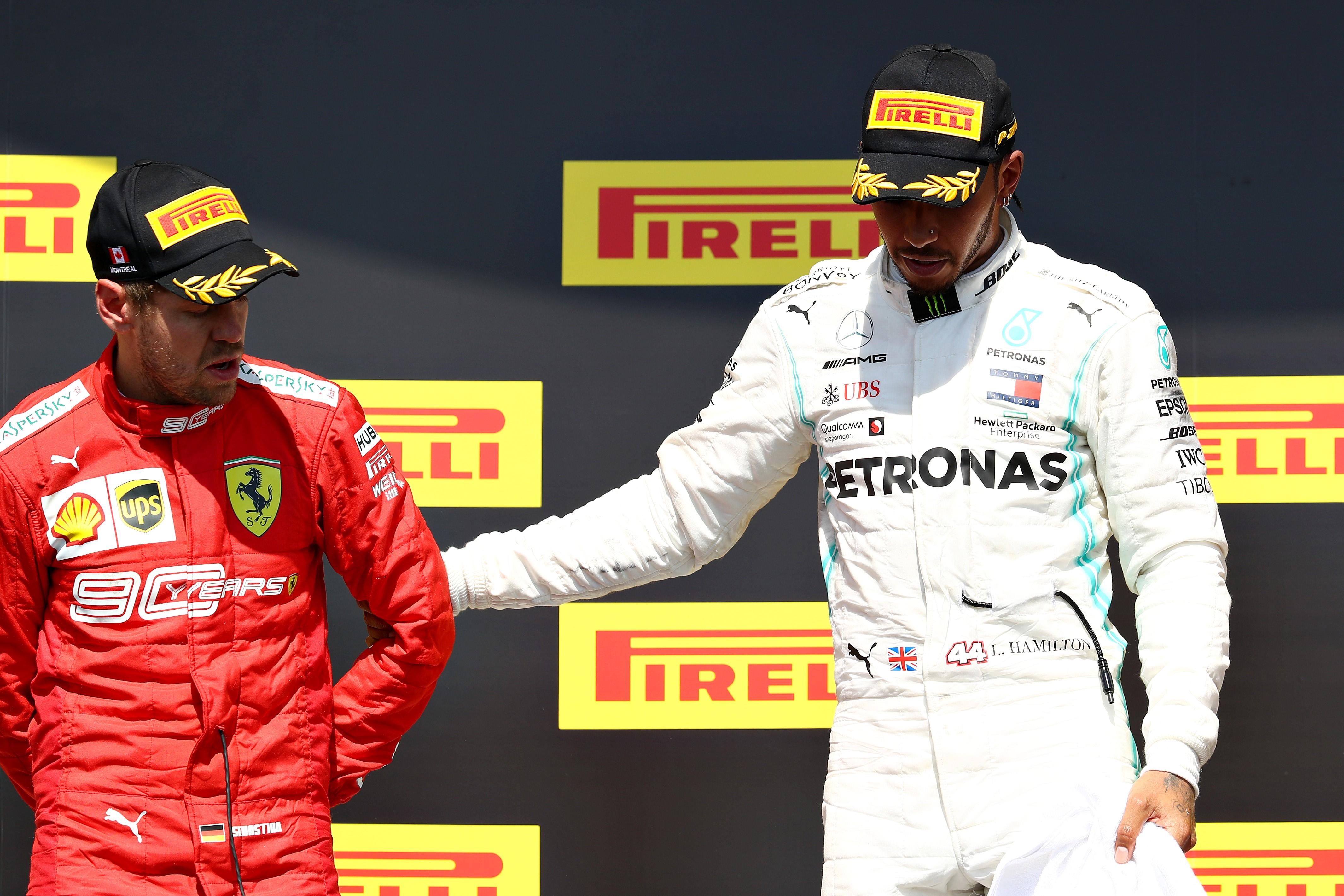Sesbastian Vettel (Ferrari) ve Lewis Hamilton (Mercedes), Kanada GP'si sonrası podyumda