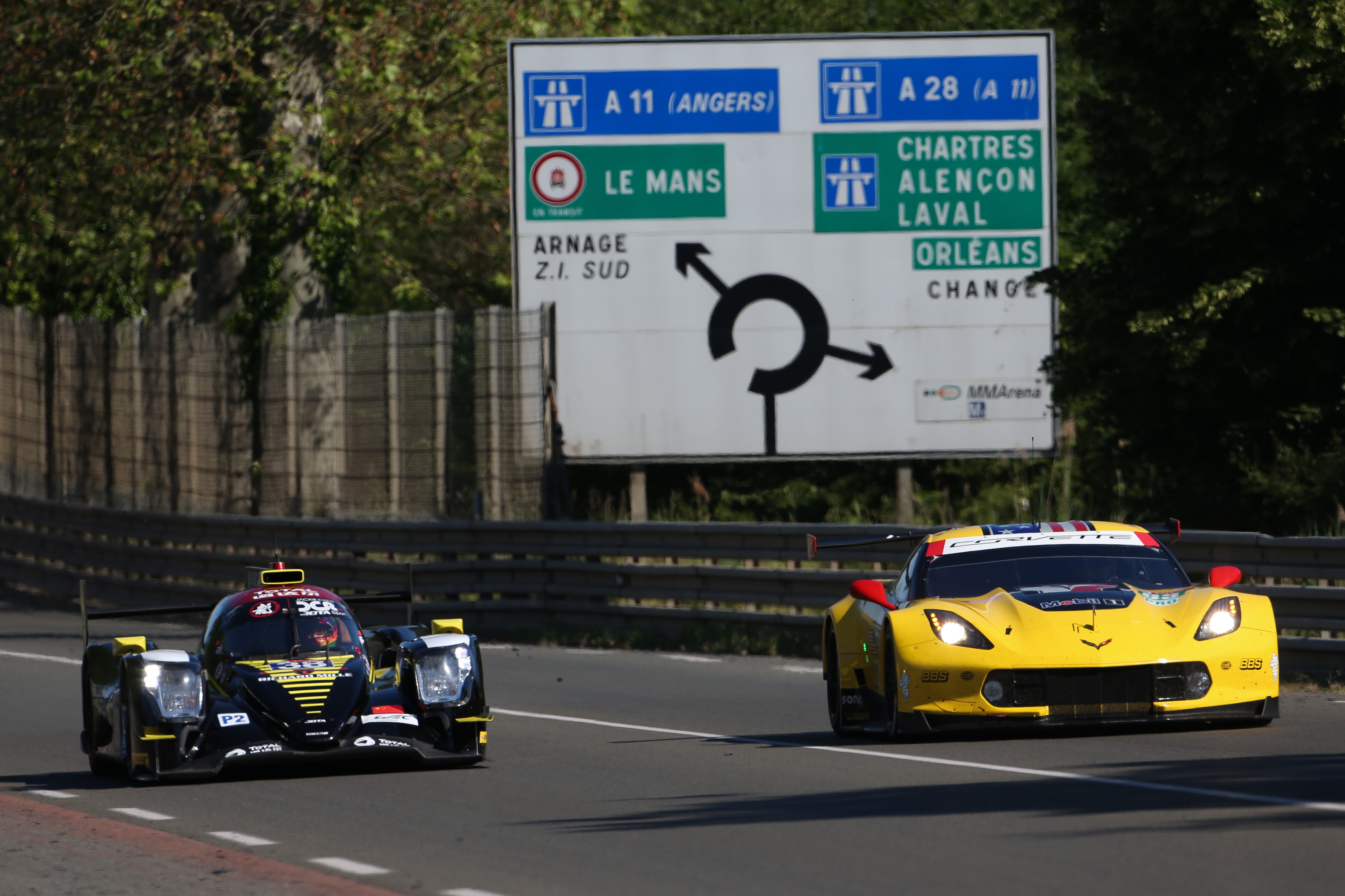 The #38 Jackie Chan DC Racing Oreca of Ho-Ping Tung, Gabriel Aubry, and Stephane Richelmi and The #63 Corvette Racing - GM Chevrolet Corvette of Jan Magnussen, Antonio Garcia, and Mike Rockenfeller in action at the Le Mans Test Day on June 2, 2019 in Le M