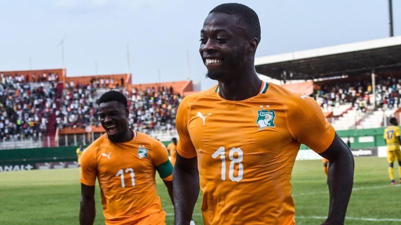 Ivory Coast's Serge Aurier (L) and Nicolas Pepe (R) celebrate a goal during the 2019 African Cup of Nations Group H qualification football match between Ivory Coast and Rwanda on March 23, 2019 at the Felix Houphouet-Boigny stadium in Abidjan.