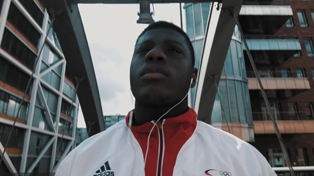 Home of the Olympics - Flag & Familiy with Peter Kadiru