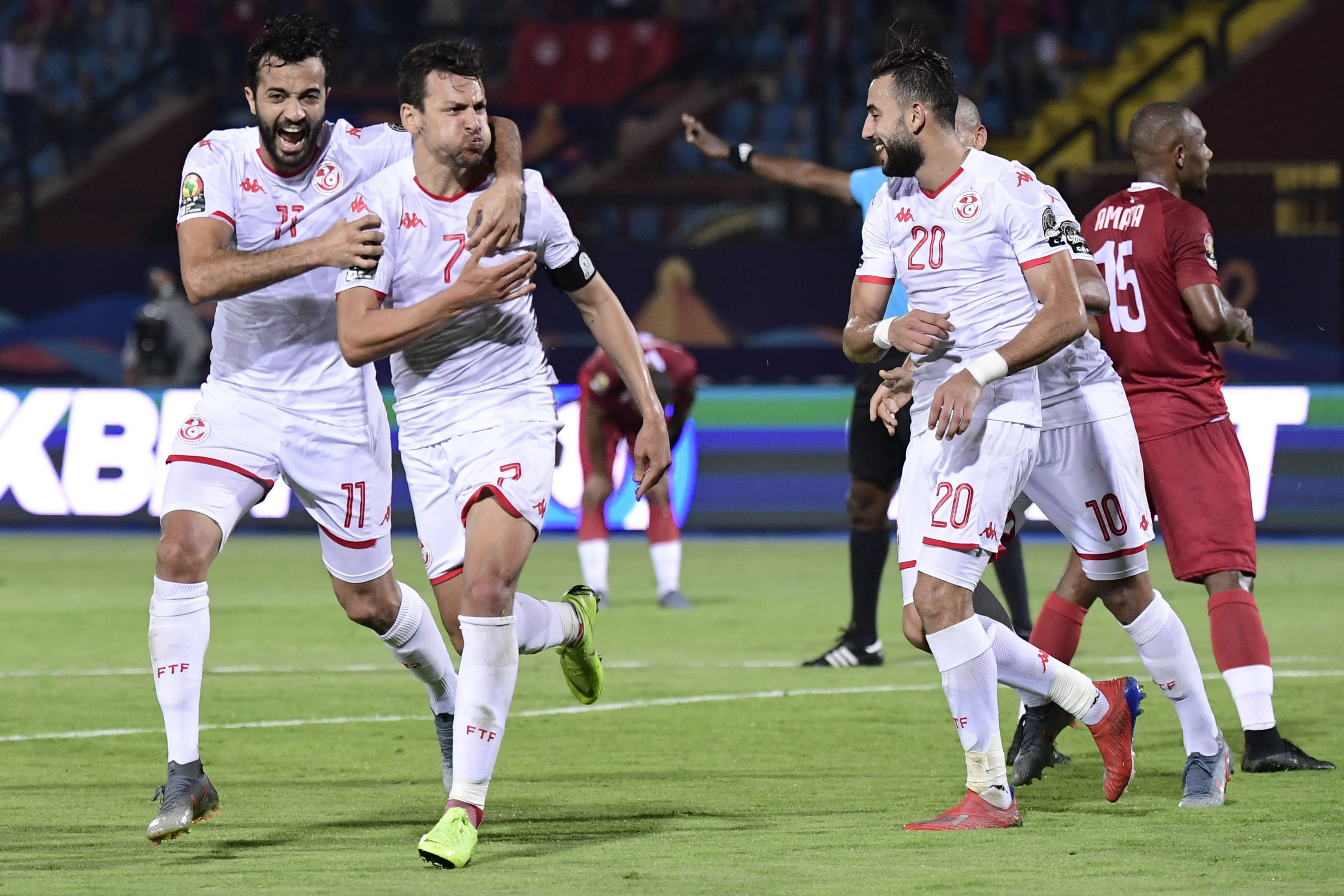 Tunisia's midfielder Youssef Msakni (C) celebrates after scoring a goal during the 2019 Africa Cup of Nations (CAN) quarter final football match between Madagascar and Tunisia