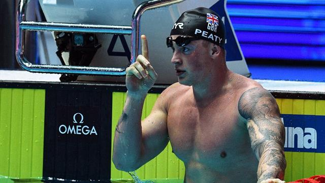 Adam Peaty breaks 100 metres breaststroke world record