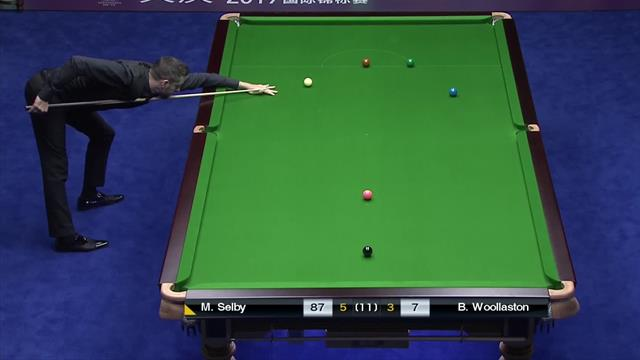 Selby recovers from two-frame deficit to beat Woollaston