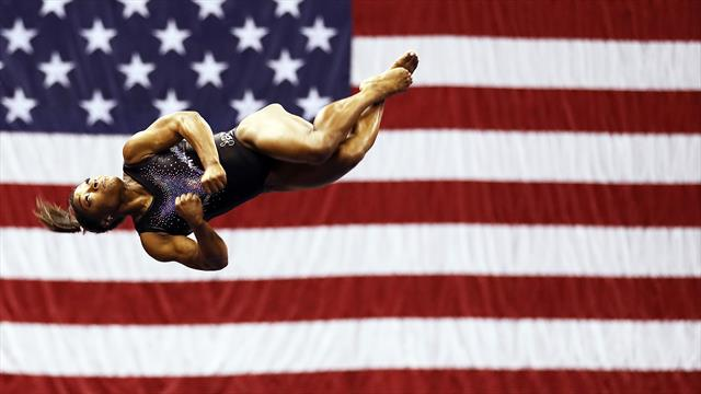Biles soars and 'mic drops' her way to record fifth all-around world title