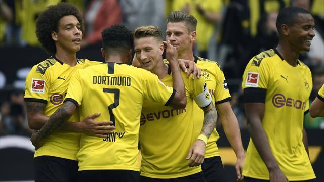 Alcacer scores two goals and assists another as Dortmund thrash Augsburg