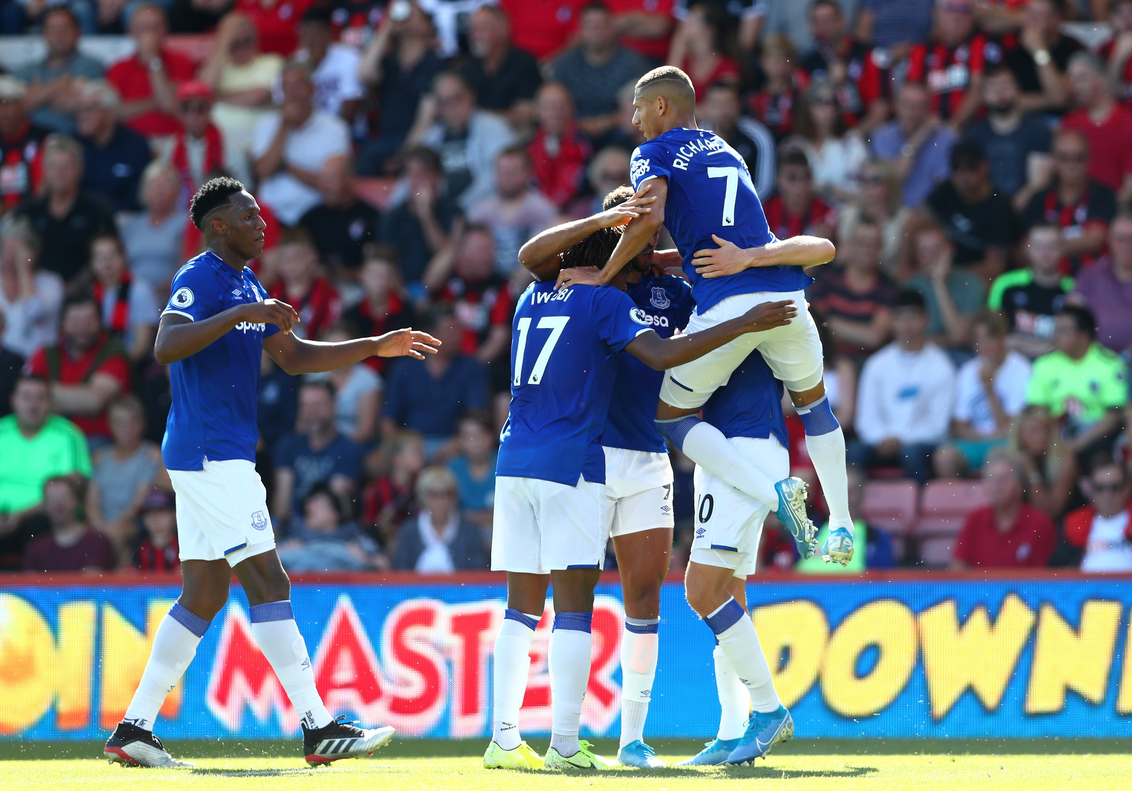 Dominic Calvert-Lewin of Everton (obscured) celebrates after scoring his team's first goal with team mates during the Premier League match between AFC Bournemouth and Everton FC at Vitality Stadium on September 15, 2019 in Bournemouth, United Kingdom.