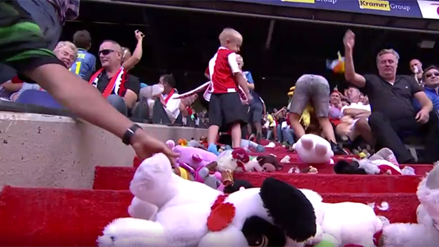 Raining teddy bears! Away fans shower kids with cuddly toys