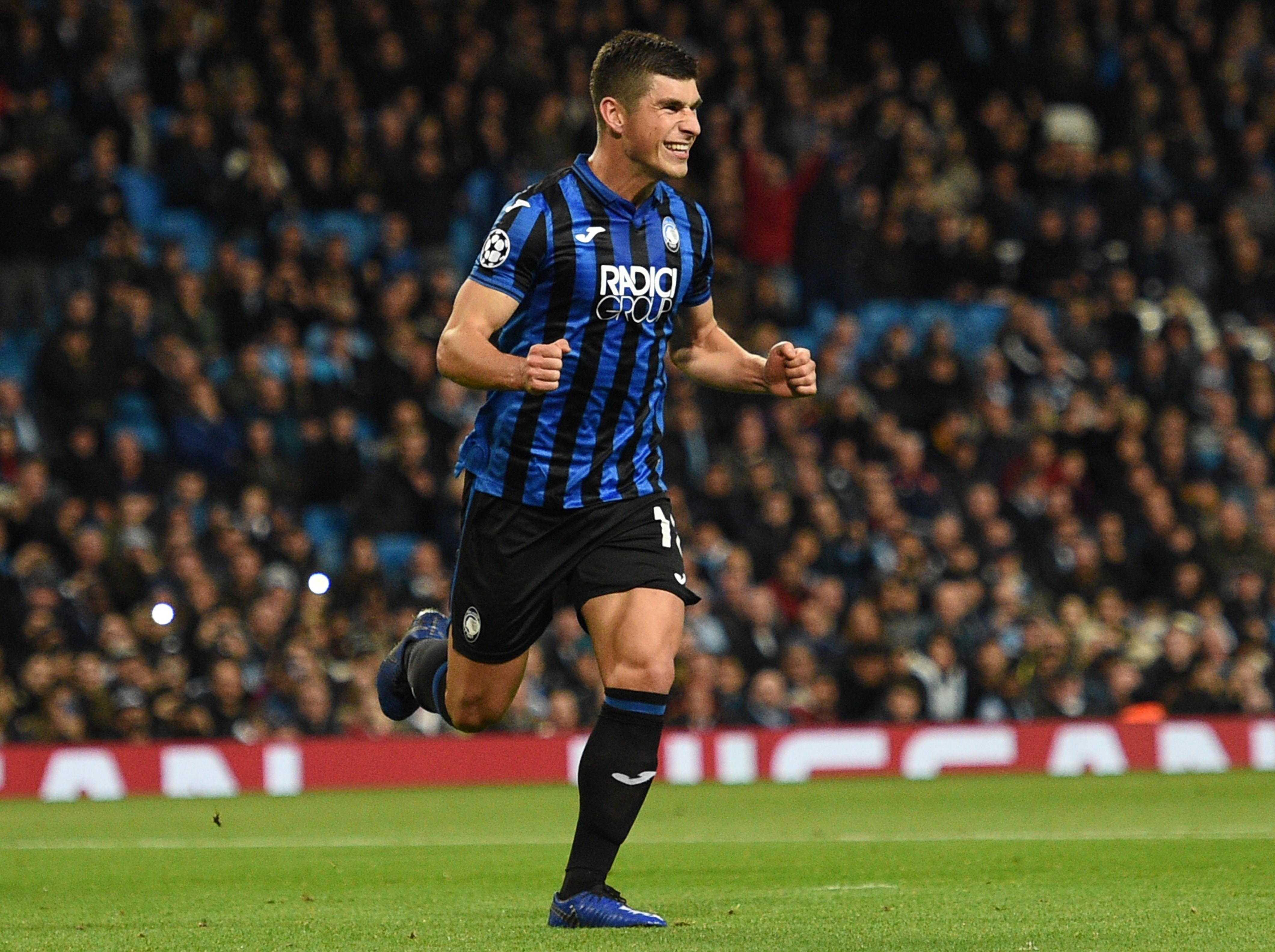 Atalanta's Ukrainian midfielder Ruslan Malinovskyi celebrates scoring the opening goal from the penalty spot during the UEFA Champions League Group C football match between Manchester City and Atalanta at the Etihad Stadium in Manchester