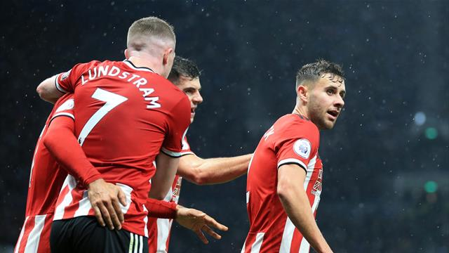 Baldock denies Tottenham victory with United angered by VAR