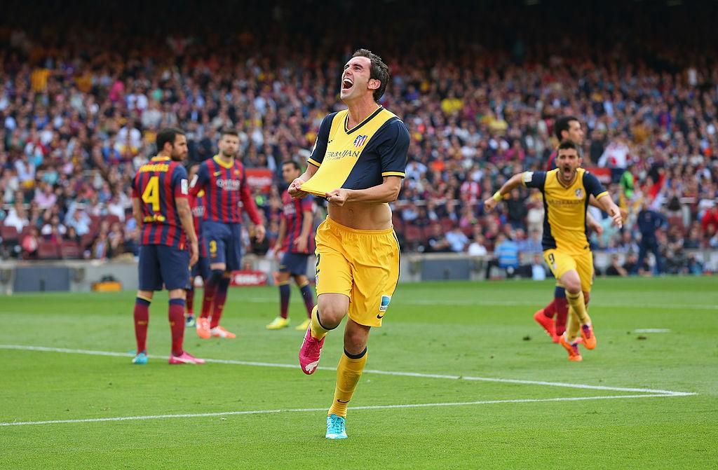 Godín celebrando el gol de la Liga