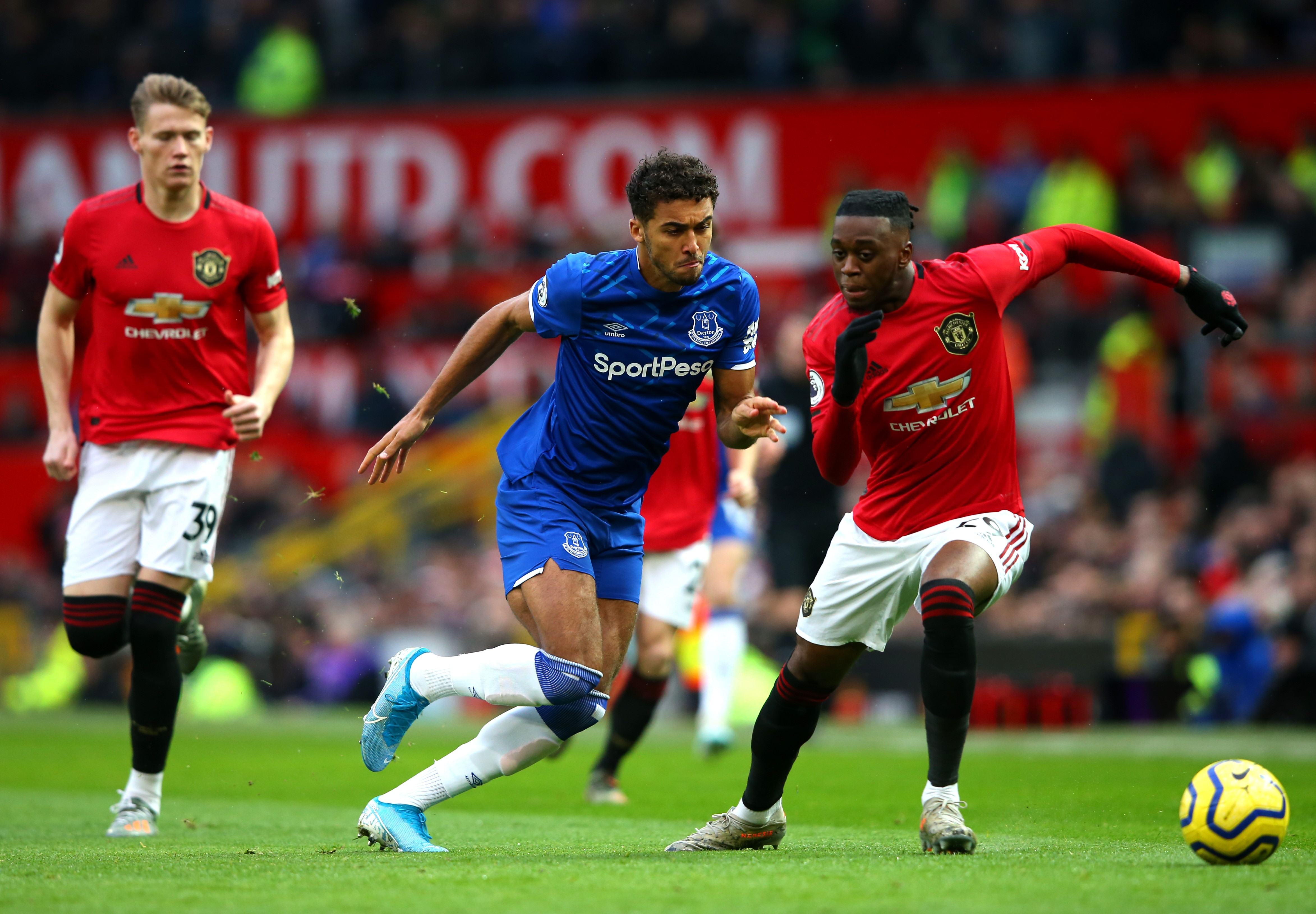 Dominic Calvert-Lewin of Everton battles for possession with Aaron Wan-Bissaka of Manchester United during the Premier League match between Manchester United and Everton FC at Old Trafford on December 15, 2019 in Manchester, United Kingdom.