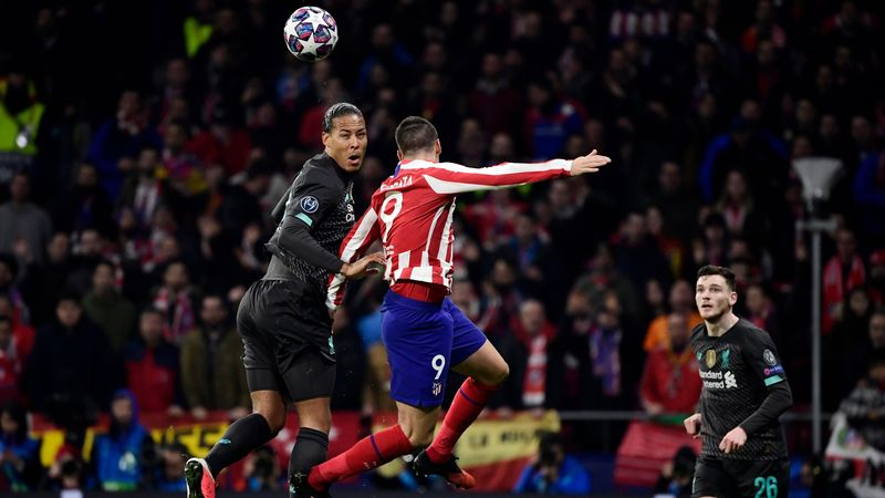 Liverpool's Dutch defender Virgil van Dijk (L) vies with Atletico Madrid's Spanish forward Alvaro Morata during the UEFA Champions League, round of 16, first leg football match between Club Atletico de Madrid and Liverpool FC at the Wanda Metropolitano st