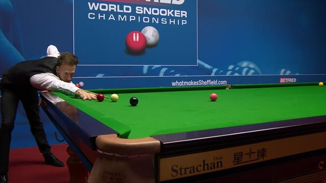 Judd Trump plays three exhibition shots, one right-handed at World Championship