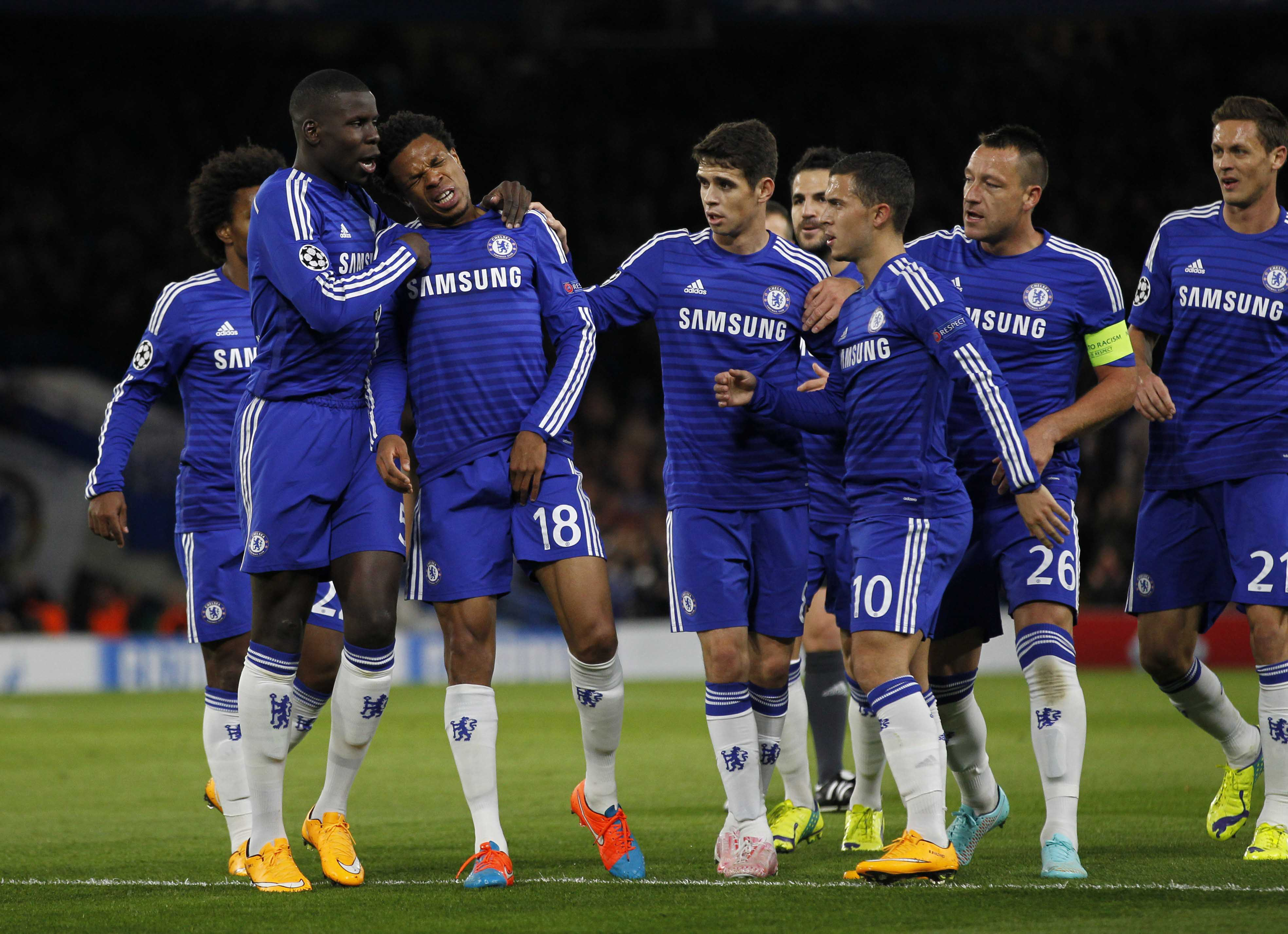 Chelseas French striker Loic Remy (3rd L) reacts as he pulls up injured after scoring the opening goal against Maribor.
