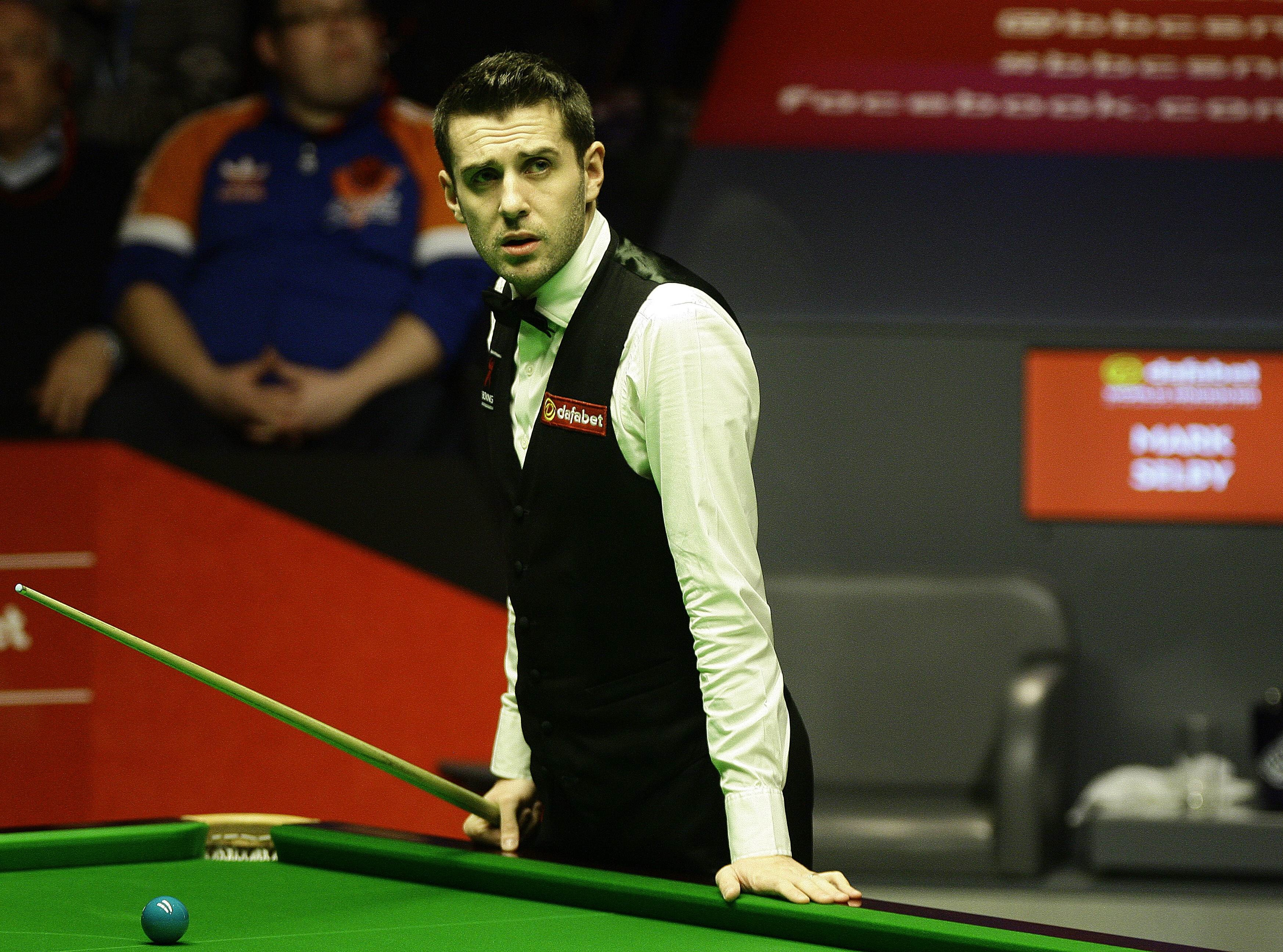 Mark Selby studies a scoreboard at the Crucible.