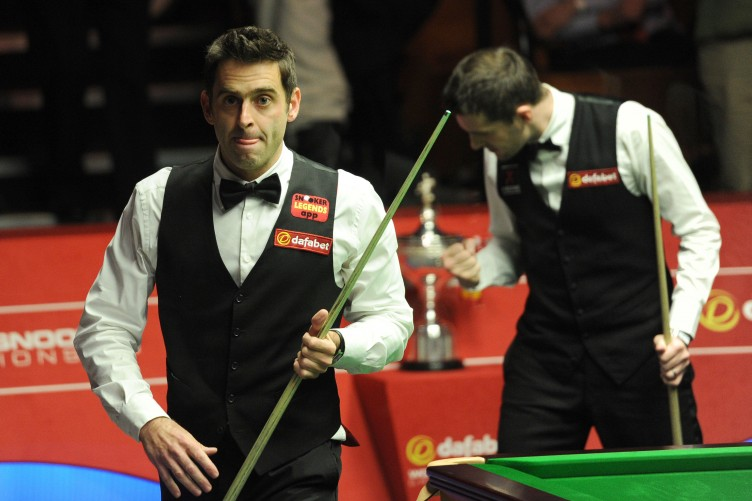 Mark Selby reacts after moving ahead of Ronnie O'Sullivan in the World Snooker Championship final session.