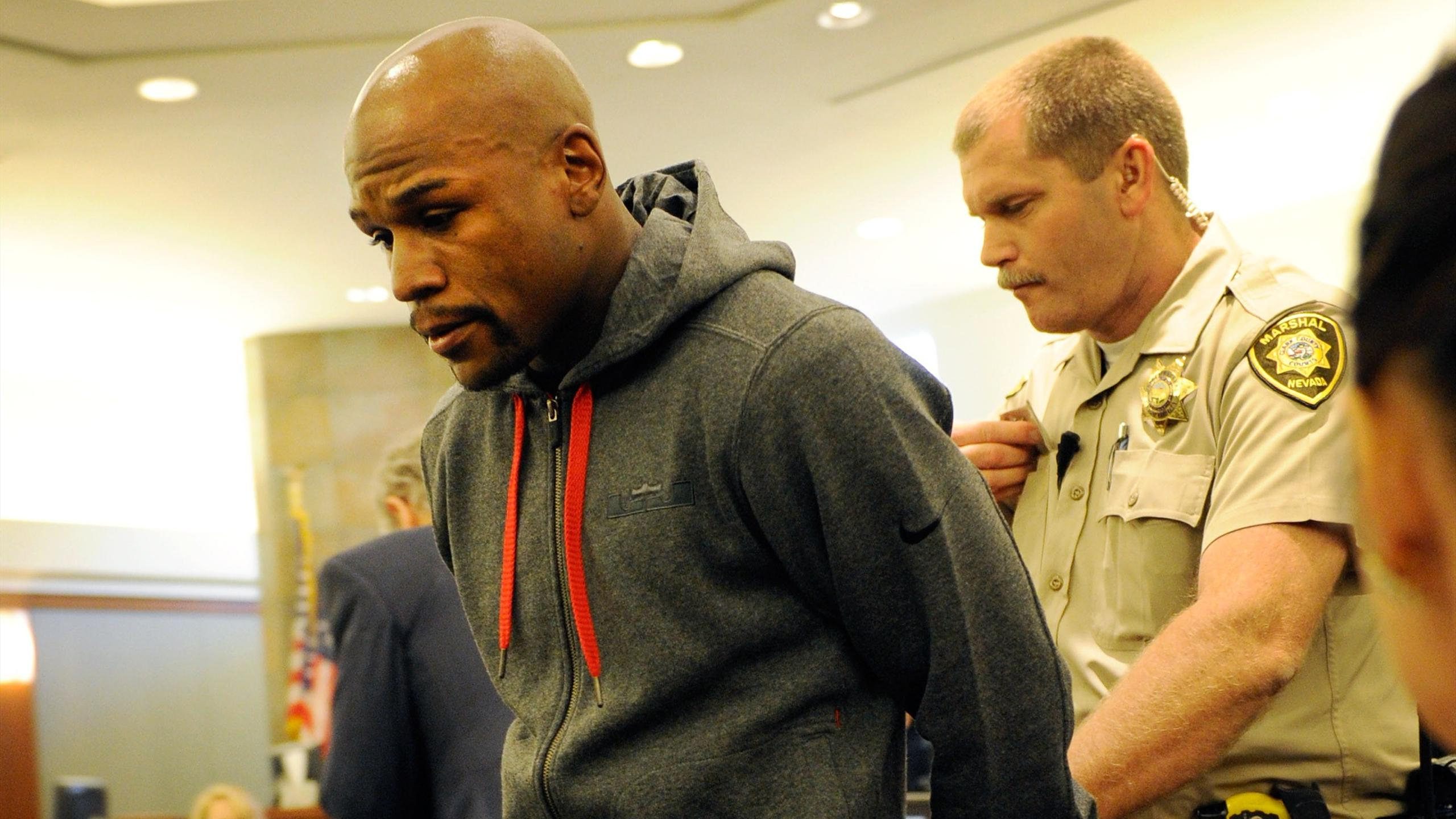 Boxer Floyd Maywether Jr. is lead away in handcuffs at the Clark County Regional Justice Center as he surrenders to serve a three-month jail sentence on June 1, 2012 in Las Vegas, Nevada