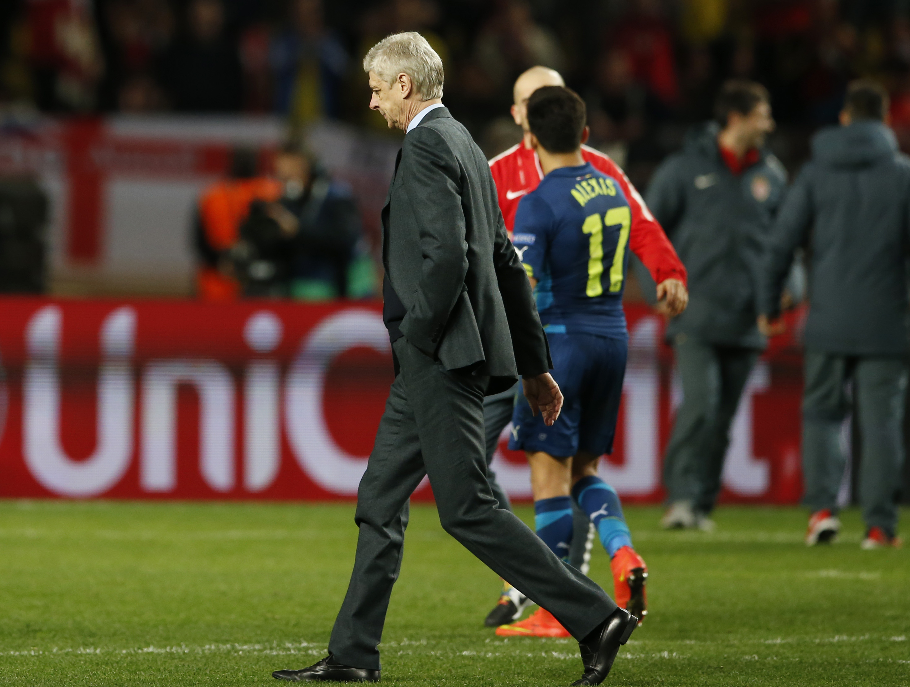 The Arsenal manager heads for the dressing room after latest Champions League exit.