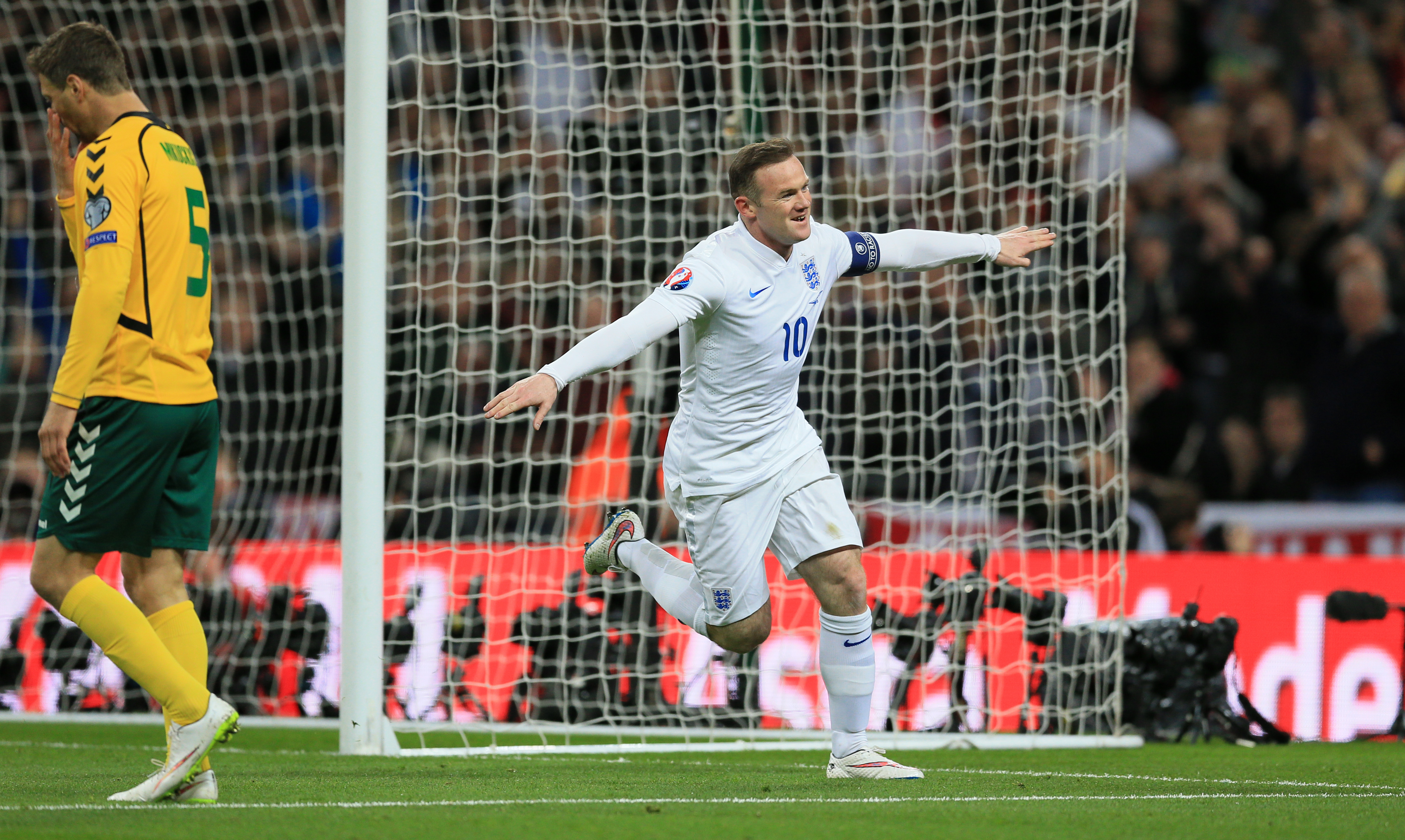 Wayne Rooney scores England's first goal against Lithuania.
