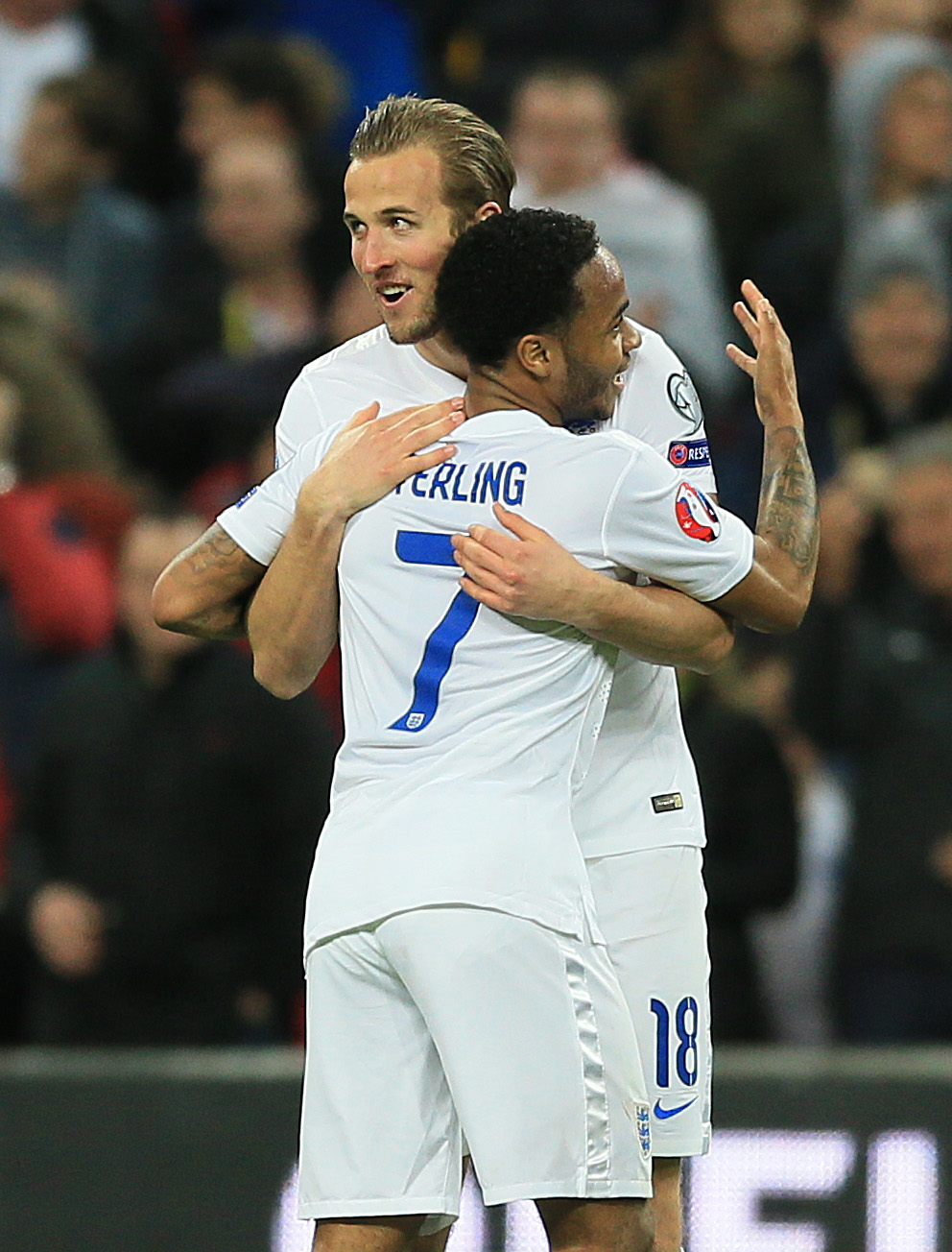 Harry Kane and Raheem Sterling celebrate England's fourth goal in the 4-0 win over Lithuania.
