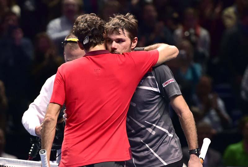Roger Federer embraces Stan Wawrinka