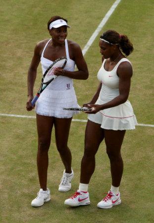 USA's Venus Williams (left) and Serena Williams (right) during their match against Slovakia's Dominika Cibulkova and Russia's Anastasia Pavlyuchenkova