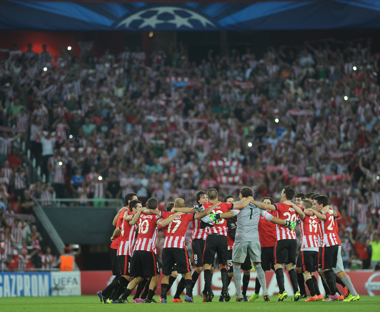 Athletic Bilbao players celebrate beating Napoli to reach the group stage
