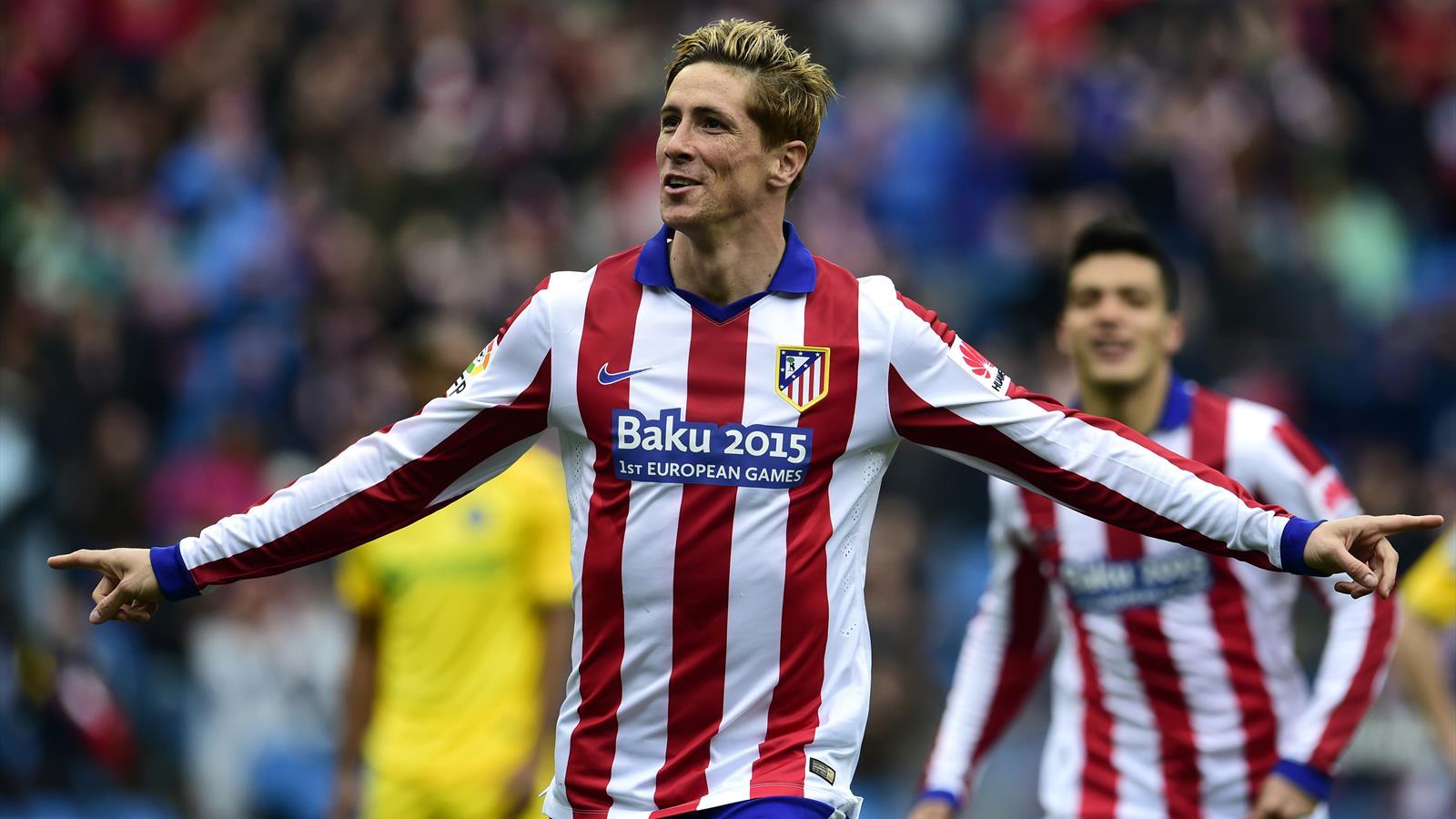 Atletico Madrid's forward Fernando Torres celebrates after scoring a goal during the Spanish league football match Club Atletico de Madrid vs Getafe