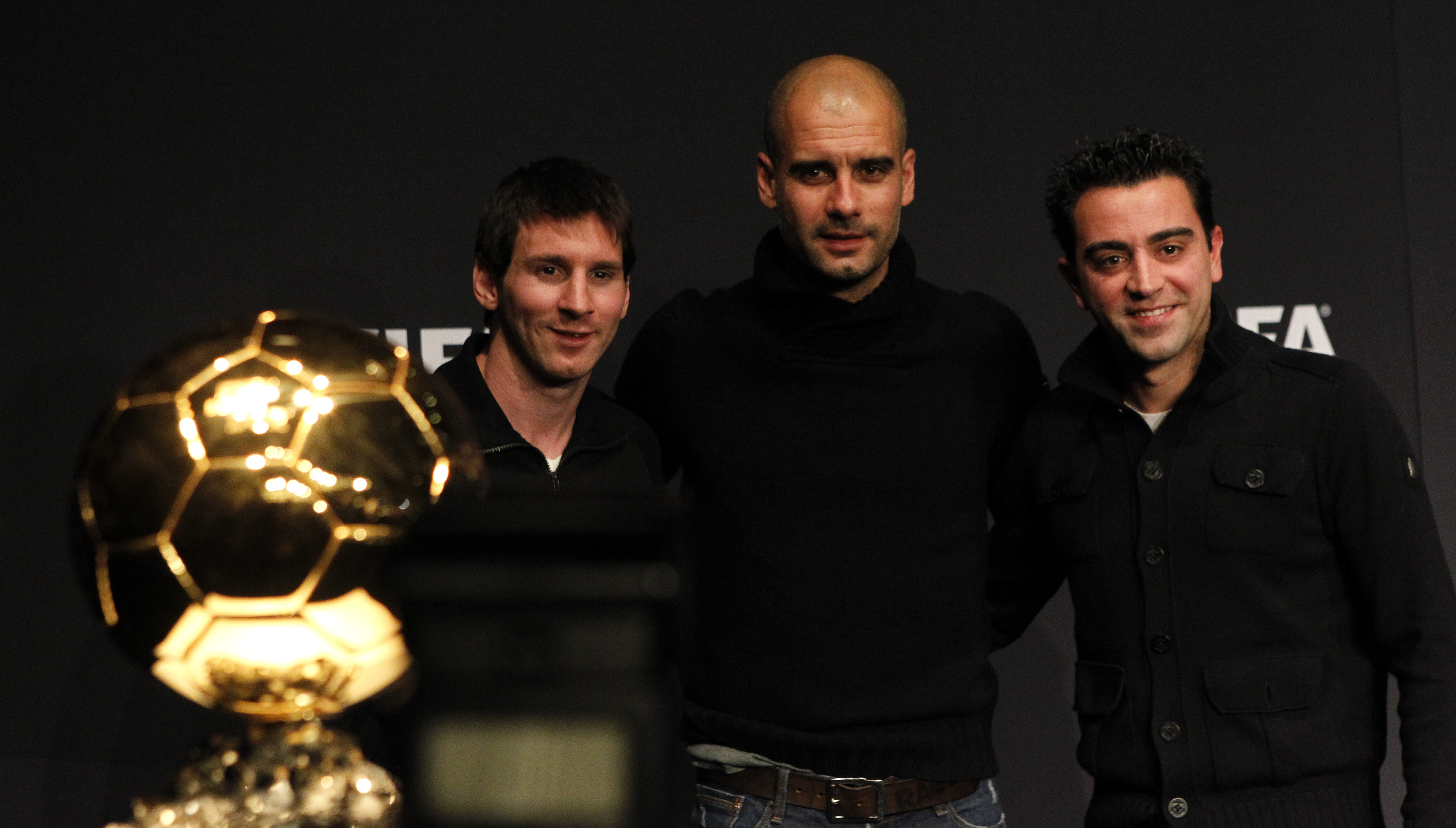 FIFA Men's World Player of the Year 2011 nominees Lionel Messi (L) of Argentine and Xavi (R) of Spain pose together with FIFA World Coach Men's Football 2011 nominee Pep Guardiola (C)