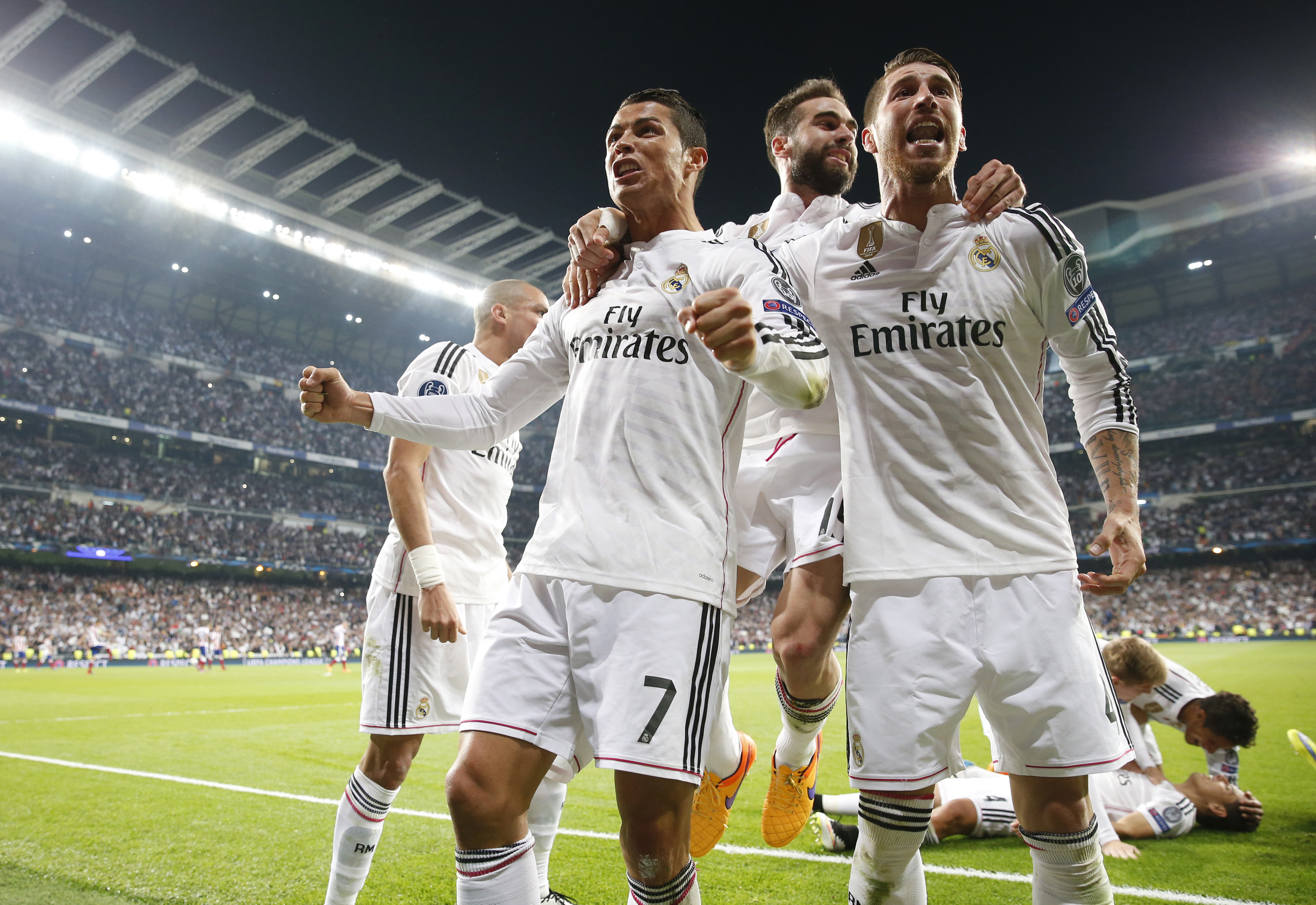 Cristiano Ronaldo, Sergio Ramos and Dani Carvajal celebrate after Javier Hernandez (not pictured) scored the first goal for Real Madrid