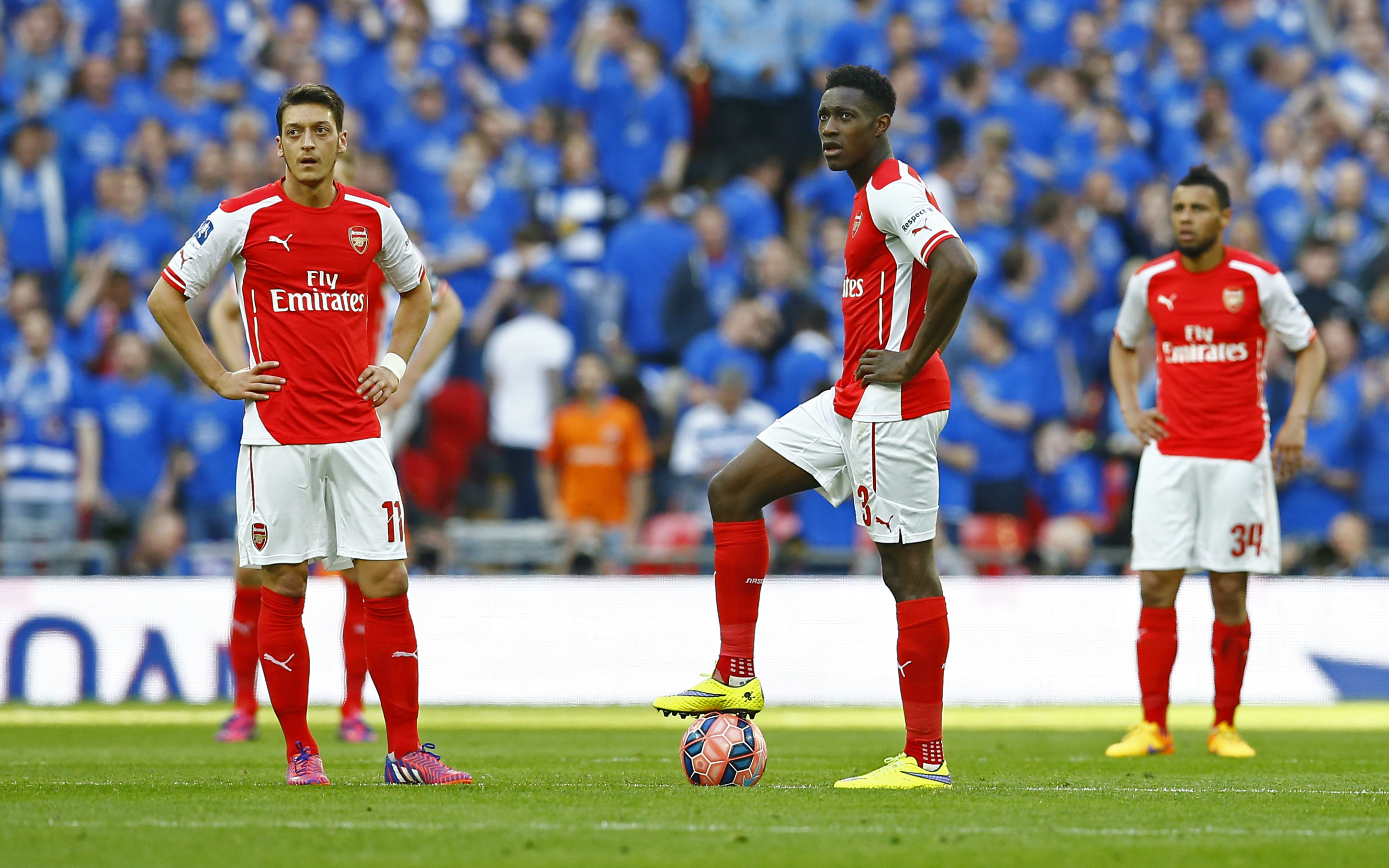 Arsenal's Mesut Ozil and Danny Welbeck look dejected after Garath McCleary (not pictured) scored for Reading (Reuters)